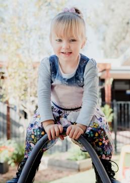 kindergarten girl on an aframe