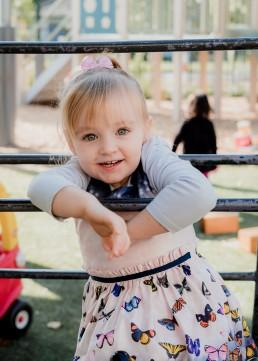 kindergarten girl on an a frame
