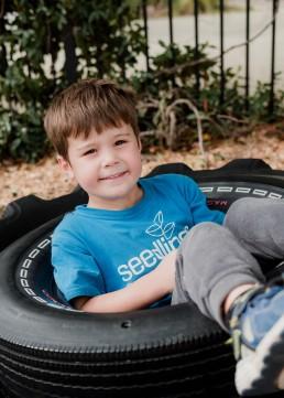 kindergarten boy in a tyre