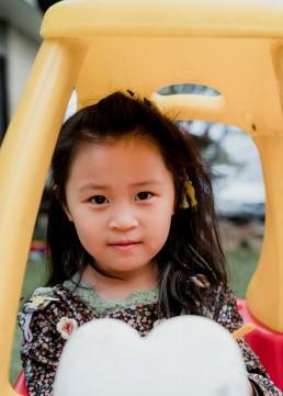 kindergarten girl portrait in a ride in car