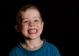 portrait of a kindergarten boy with smiling big teeth