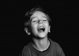 photographs of a boy laughing in his kindergarten photographs