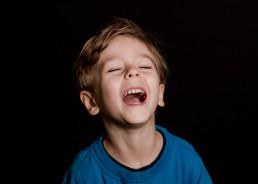 portrait of a kindergarten boy laughing