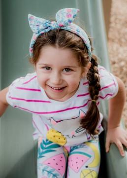 kindergarten girl on slide