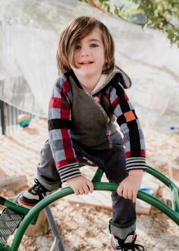 kindergarten boy on a frame