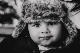 little boy portrait wearing cute fluffy hat